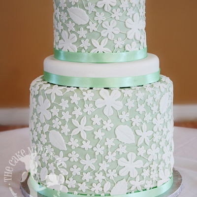 Mint Green Lace Wedding Cake A gorgeous design of lace with a mint green back drop.