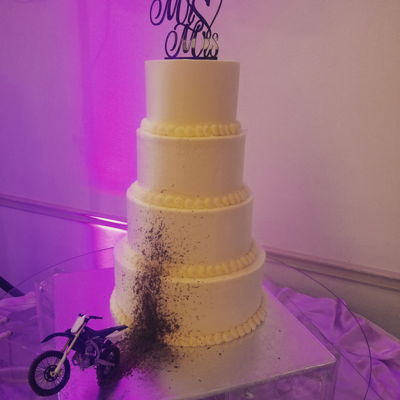 Mud Splatter Dirt Bike Wedding Cake Chocolate mud splattered up the front of a simple, elegant wedding cake. The groom is a dirt bike enthusiast so the bride took a creative...