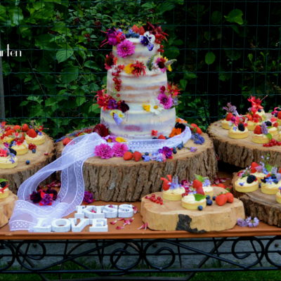 Summer Wedding Cake And Tarlets With Edibe Flowers