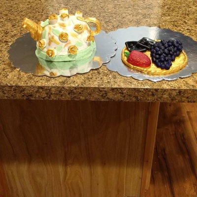 Teapot Cake With Fruit And Crackers This was a moist, lemon sponge cake I made for a company BBQ. I'm a rookie to working with fondant but I'm proud of it. I had a...