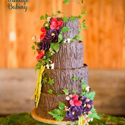 Tree Trunk Wedding Cake This cake was made with fondant and modeling chocolate to create tree bark textures. All the florals are made with gum paste and Flexique...