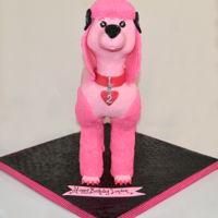 3 D Pink French Poodle champagne cake carved and covered with buttercream and then with modeling chocolate. Rice cereal treat head, legs, tail. Accents made with...