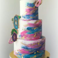 Agate Geode Wedding Cake Hand painted fondant wedding cake with isomalt sugar agate geodes.