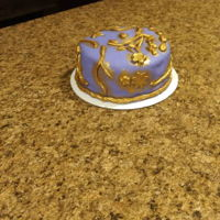 An Elegant Birthday Cake For An Elegant Lady This is a multicolored, vanilla cake under purple Fondarific fondant with gold accents. I made it for a friend's birthday! Its a...