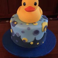 Baby Shower Cake For My Daughter. This was a Dutch chocolate cake filled with blue buttercream. Covered in milk chocolate ganache then fondant. The theme was Duckies so it...