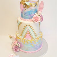 Boho Themed I did a watercolor technique and used edible gold leaf for this cake. Wafer paper feathers and gumpaste flowers. Dream catcher was made...