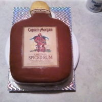 Captain Morgan Bottle Cake Red velvet cake with cream cheese filling and frosting and modeling chocolate decorations