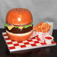 "Cheeseburger And Fries Cheeseburger and Fries anyone??? This cake is made from two 8"" half ball cake pans and one 8"" round. I cut more off of the bottom..."