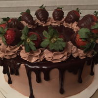 Chocolate Covered Strawberry Cake Chocolate cake filled with strawberry ganache and chocolate buttercream. Covered with a chocoalte swiss meringue buttercream and chocolate...
