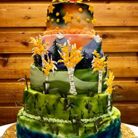 Colorado Mountain Wedding Cake Each tier of this cake represents a landscape of Colorado - river, plains, foothills, alpine, and sky. The wedding was help up in the...