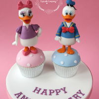 Donald & Daisy Cupcakes For a first wedding anniversary.