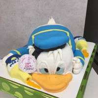 Donald Duck Drunk DAIQUIRY CAKE (STRAWBERRY AND LIME CAKE WITH BUTTER RUM BUTTERCREAM, CHOCOLATEMARBLE VANILLA AND CHOCOLATE CAKEBUTTERCREAM COVER WITH...