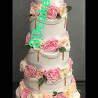 Drapes, Roses, Wedding Cake With Dividers . Wedding cake with dividers between & flowers.