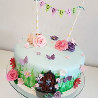 Fairy Schoolstart Cake Cake for school beginner with flowers and butterflies. And the door as a symbol for a new chapter of life.