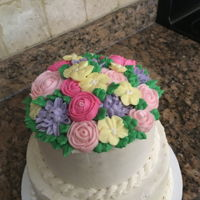 Flower Cake The flowers were made on wax paper and then frozen so they could be picked up and placed on the cake. The cake was decorated entirely in...