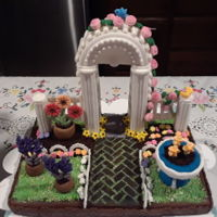 Garden For Tea Party All edible made with cookies,fondant and sprinkles. Thanks to Julia Usher.