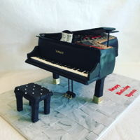 Grand Piano Marzipan cake. All edible except for legs. Bench is made of modeling chocolate.
