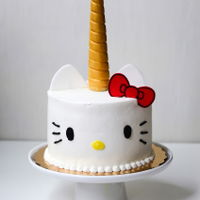 Hello Kitty Unicorn Cake hello kitty unicorn cake - vanilla chiffon cake filled with lemon whipped cream and fresh blueberries