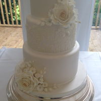 Ivory Wedding Cake Simple ivory wedding cake with hand piped lace