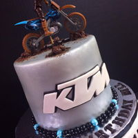 "Ktm Dirt Bike Cake 6"" fondant covered and airbrushed."