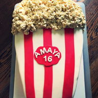 Movie Popcorn Birthday Cake This was for my niece's movie themed sweet 16. My first fondant covered cake, my first sheet cake and my first carved cake. I'm...