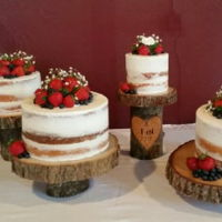 Naked Wedding Cake Naked wedding cake with strawberries, blueberries and baby's breath.
