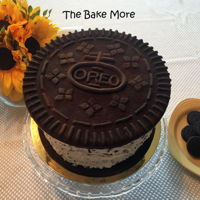 Oreo Quadruple Stuf Cookie Cake Oreo cake sandwiched between two shortbread cookies