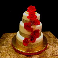 Red And Gold Bridal Shower Cake Three tiers white cake with American butter cream and fondant, roses are modeling chocolate and gumpaste, than you for looking