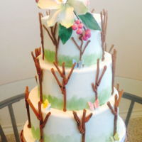 Simple Tree Wedding Cake Three tier tree wedding cake. The trees are made from royal icing and cake decorated Cymbidium Orchid flowers.