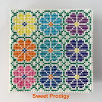 "Summer Garden | Sweet Prodigy This is a 5"" x 5"" sugar cookie decorated with royal icing. I used a PME piping tip No. 1 for the grid and for the dots."