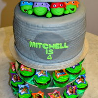 Teenage Mutant Ninja Turtles Chocolate Mud Cake with Fondant Decorations Chocolate Cupcakes with BC and Plastic TMNT Rings