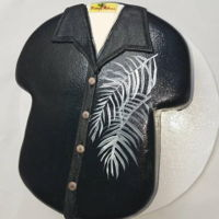 Tommy Bahama Shirt Cake Coconut cake with lime buttercream, finished in fondant and painted with black Edible Art Paint