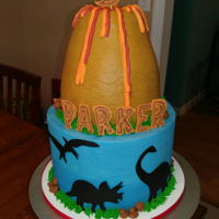 Volcano With Dinosaurs All buttercream and chocolate except the fondant dinosaur cutouts.