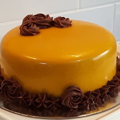 Caramel Mirror Glaze Caramel Mirror Glaze over chocolate