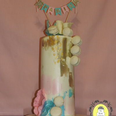 Contemporary Watercolor Birthday Cake A white chocolate raspberry barrel cake that is decorated with pulled sugar, modeling chocolate and french macarons.