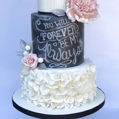 Forever And Always Chalkboard 25th Wedding Anniversary cake with sugar flowers and silver leaves.