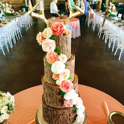 Rustic Bark Wedding Cake W Edible Antlers Tree stump design with modeling chocolate antlers. Wafer paper roses and garden roses cascading in blush and coral.