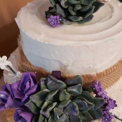 Rustic Buttercream With Succulents This is a buttercream cake with gum paste succulents and piped on rosette border. Also used burlap ribbon.