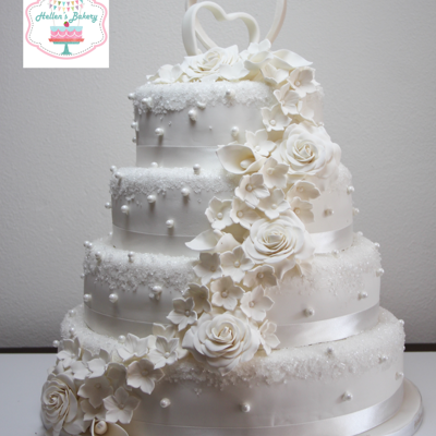 White Wedding Cake Wedding cake, decorated with rosés, calla Lilles and small flowers. Cristalizing sugar and Pearls