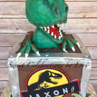 3D Dinosaur Cake Wooden crate cake with 3D dinosaur topper
