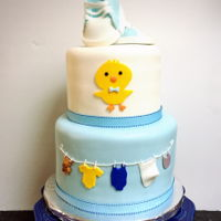 Baby Shower Cake For Boy Fondant and edible baby shoes