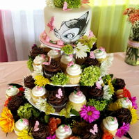 Bambi Cupcake Wild Flower Tower This is extremely cute for a baby shower. Just by the moss, greens, and flowers wether silk or real and put them in between the cupcakes.