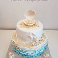 Beach Themed Wedding Beach themed wedding cake with ruffles, shells and pearls.