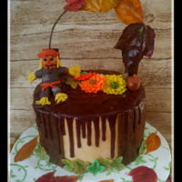 Happy Thanksgiving Chocolate drip cake with peanut butter smbc. Wreath with real fall leaves, gumpaste mums and a scarecrow.