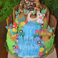 Moana Maui Birthday Cake Maui Character cake make with gum paste characters and decorations.