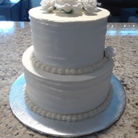 Wedding Cake Marbled cake with chocolate cream and buttercream. Fondant white roses.