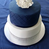 Wedding Cake Simple, yet elegant, wedding cake.Bottom tier, Blue Velvet cake, with buttercream filling, finished with purchased bling ribbon. Top tier,...