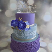 Weddingcake So happy with this weddingscake. Something different, purple and grey. It matched the venue perfectly!