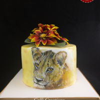 Young Lion Hand painted chocolate cake I did for my cousin's birthday. She loved it. We both grew up in African countries and spent the majority...
