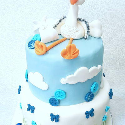 Baby Shower Cake lovely sweet stork cake topper for a baby showercake.Always so special.handformed stork, and painted the grass on.